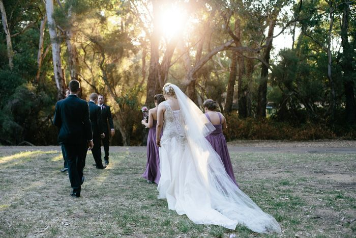 Laced up wedding dress, long veil & train.
