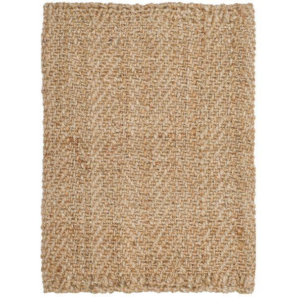 "A versatile foundation to your favorite aesthetic, this hand-woven rug is a perfect finishing touch to your well-appointed home. Crafted in India from jute fibers, this understated rug's natural hue blends effortlessly into both monochromatic or vibrant palettes, while its .5"" pile adds a touch of texture to your decor. Add this area rug to the entryway to define high-traffic areas, then lean into this piece's coastal influence by rounding out the room with a wicker-rattan arm ch..."