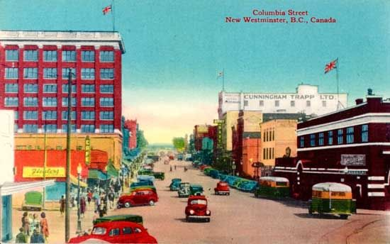 1930s photograph shows a view looking east on Columbia at Eighth Street. The B.C. Electric station, Westminster Trust Block and Trapp Building can be seen. A couple of Pacific Stage Lines buses can be seen at the BCER bus terminal. IHP7726