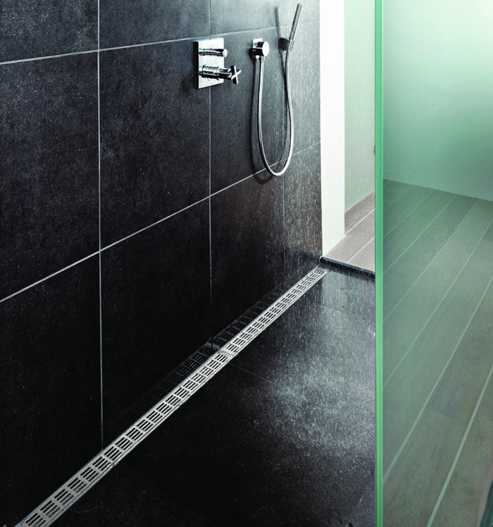Bathroom with a costumised modular line floor drain system. Elegant grating and frame in brushed stainless steel.  unidrain®: Modul 1100 & ClassicLine #bathroom #badeværelse #nordic #design #inspirational #module1100 #materials #largeshowerarea #shower #showerscreen #frostedglass