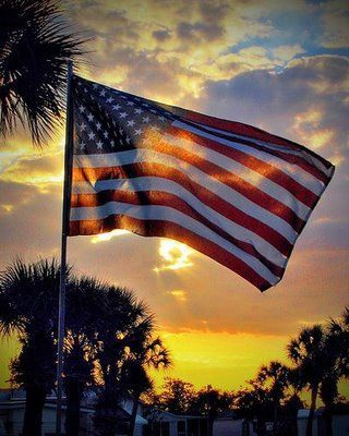 pinning this as it brought to mind a picture I took at the Norfolk Naval Shipyard about 31 yrs ago...we were on one of the ships and there were American flags flying freely in the ocean breeze. The sun shining through the flag captured my eye and made for a beautiful picture and lasting memory...I am proud to be an American!