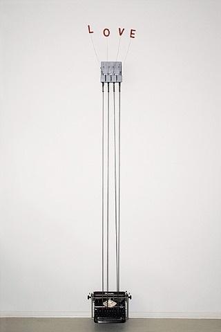Rebecca Horn   Love Olympia, 2010 [Materiali: macchina da scrivere Olympia, acciaio , lettere, solenoide, barre d'acciaio , controller, strumenti elettronici; dimensioni:102,4 x 15,7 x 15,7 pollici]
