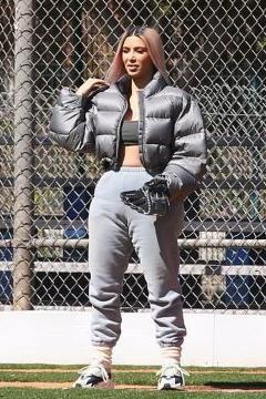 50c50d5ce5b Kim Kardashian wearing Adidas Yeezy Wave Runner 700 Sneakers