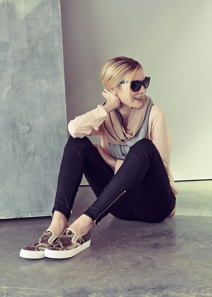 For a weekend-forever look, pair coated denim with a silk tunic. Then add an infinity scarf, slip-on sneaks, and oversized sunglasses.