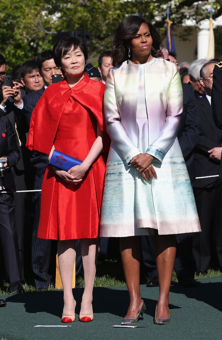 She wears a matching pastel coat and dress with the First Lady of Japan, Akie Abe, welcoming the Japanese Prime Minister and his wife to the White House.   - ELLE.com
