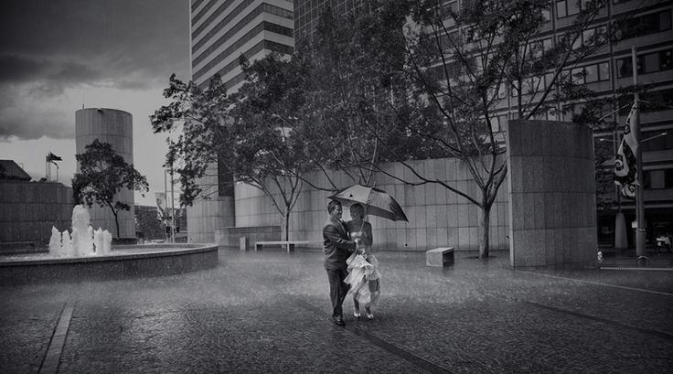 Wet weather wedding photo. You can still have fun in the rain on your wedding day. Image: Cavanagh Photography http://cavanaghphotography.com.au
