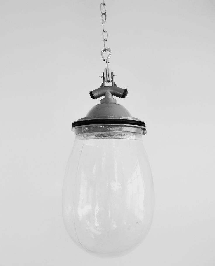 Glass Drop (Grey) An oversized glass bulb made from a rough mould gives this light a great vintage feel. Manufactured in the traditional style, each piece has slight imperfections to give it a unique look. Also available with a black fitting.