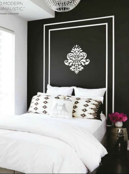 Nothing wrong with painting a Headboard on your wall...this looks great. Would be great for a teen girl or guest bedroom.