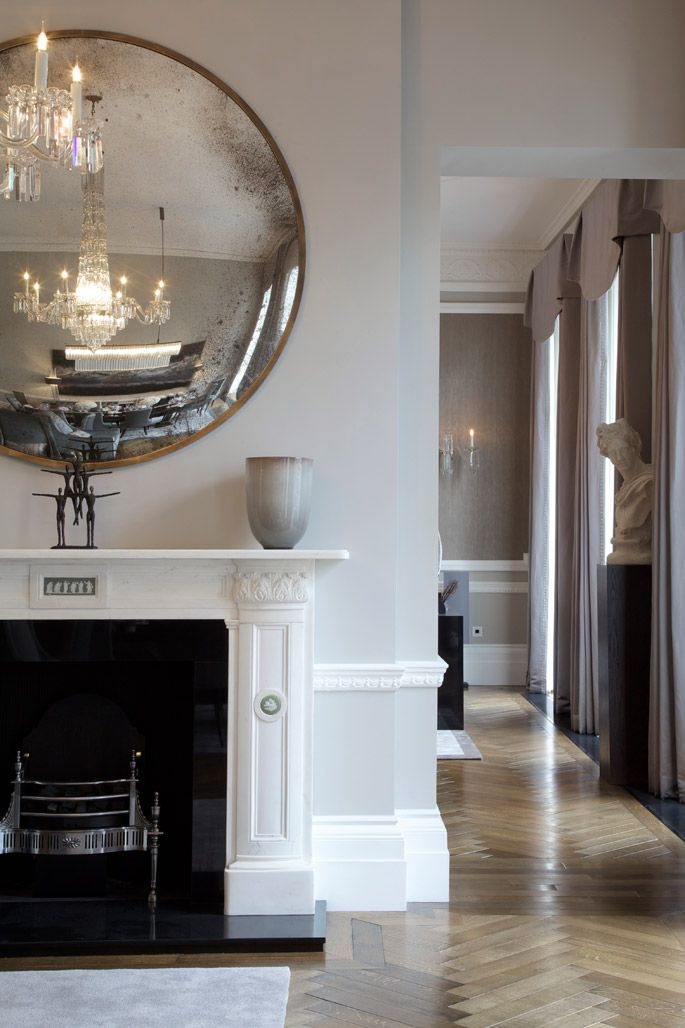 Lovely mirror and a modern twist with classical compliments - see bust on plinth.. Don't like the curtains- I'd probably go with a plainer style in a stripe and more interesting vase a little bigger than the one shown.... AJ