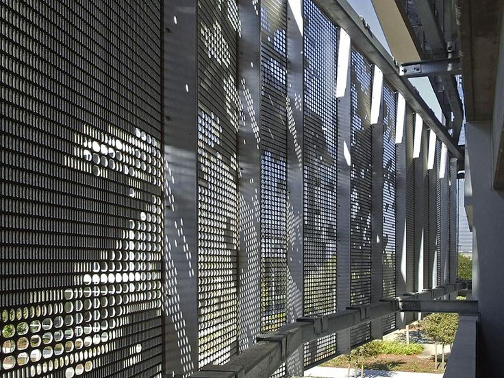 Superb Photo Of Detail Of The Perforated Aluminum Facade System From Within The  Garage Ideas