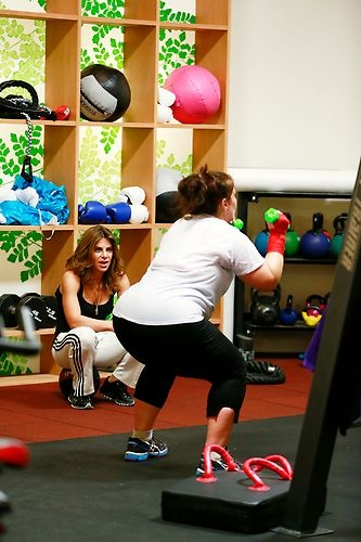 Danni works her legs with some squats. #BiggestLoser