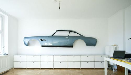 No paintings? Just throw a car up on the wall!