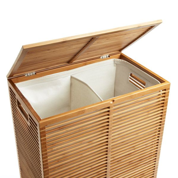 Zen Bamboo Laundry Hamper -  It has a covered hinged lid and a divided interior liner. Bamboo is easily renewable, so it's an environmentally friendly material. The liner is coated in polypropylene so it can be wiped clean. Integrated handles.