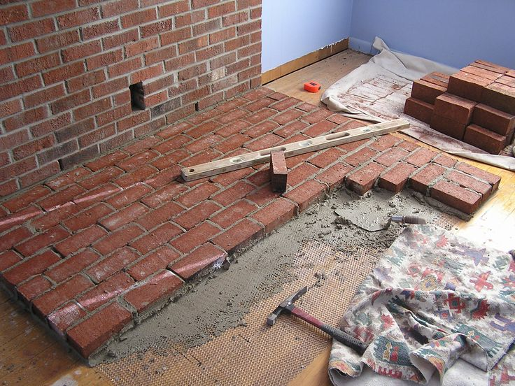 Construction of the brick hearth for free standing wood burning stove.