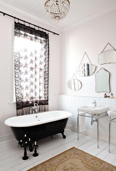 black bath, black lace curtain panel, vintage mirrors
