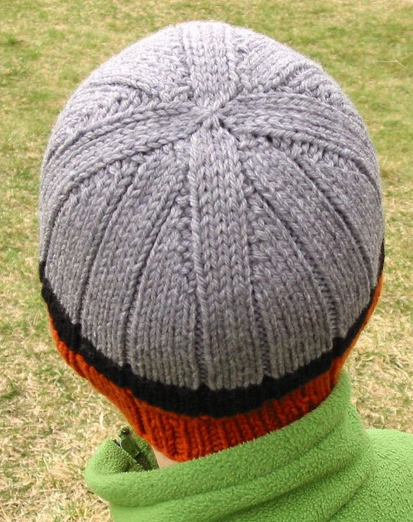 Free Knitting Pattern for Easy Rib-a-Roni Beanie - Very easy unisex ribbed beanie with decreases that create an interesting geometric design by Jane Tanner in sizes for baby, child, youth/small, adult medium, adult large