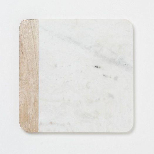 tabla de quesos de marmol y madera. Tendencias de Decoración