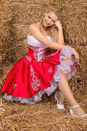 Piros-fehér zsinóros menyecske ruha, a pörgős szoknyán több helyen felnyúló zsinóros mintával