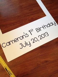 """DIY First Birthday Party Photo Booth Have someone take photos of all the guests holding this to put together a """"guest book"""" later of who was at the party. Also have a cute backdrop behind... Streamers or wrapping paper"""