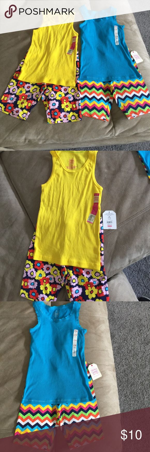 Girls bike shorts and tank top Girls size 7/8 tank tops and bike shorts. Yellow tank top, both bike shorts are Faded Glory. Blue tank top from Kohls SO (Authentic American Heritage). All NWT. Matching Sets