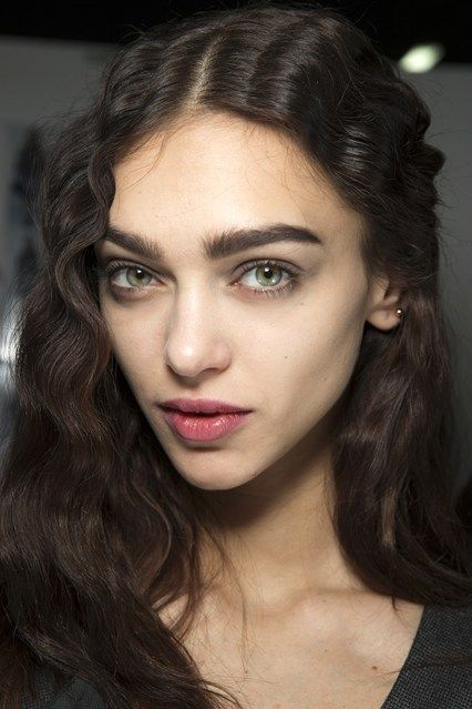 Backstage Beauty: Autumn/Winter 2014 - Giorgio Armani/ Linda Cantello used strong brows, faded berry lips and grey smoky eyes to complement the hazy grey hues in the collection, whilst hair by Roberta Bellazzi was styled in rippling waves.
