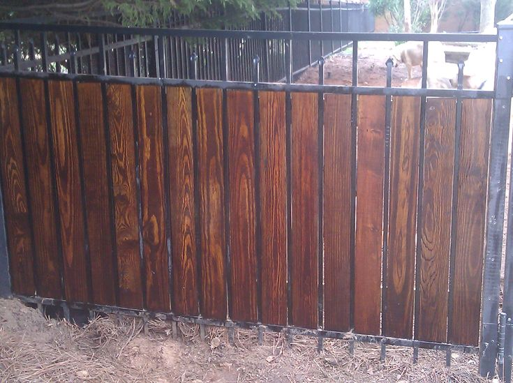 If you need a privacy fence and can't afford thousands for a new one, you can improvise by adding stained wood pickets to your current aluminum or wrought  iron fence.