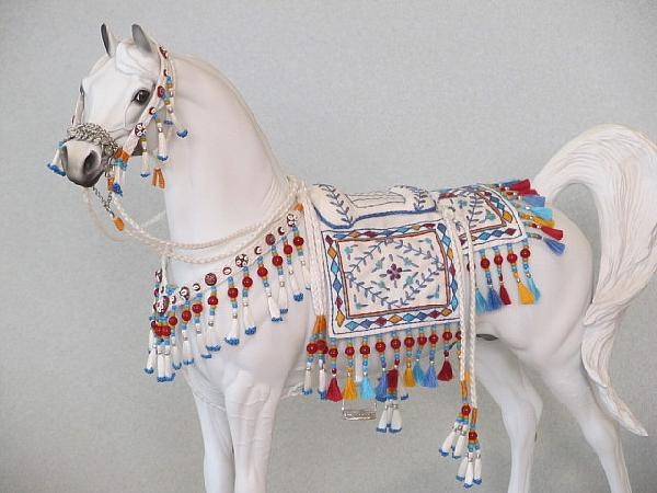 Hand Embroidered Bedouin Saddle for Model Horses. One of the prettier ones I've seen. Though I could totally see keeping the same shape and changing the color scheme of the beads, too.