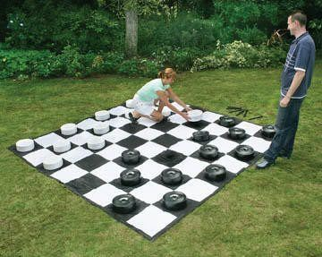 Giant outdoor checkers played on a durable 10' x 10' mat. Outdoor fun for all ages. Set out this giant game and keep your guests entertained at your party, event, or outdoor area. You've seen them at