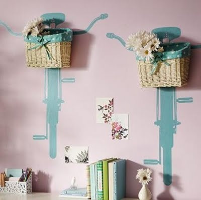 Bike decals with baskets attached to wall for storage or display. Too cute