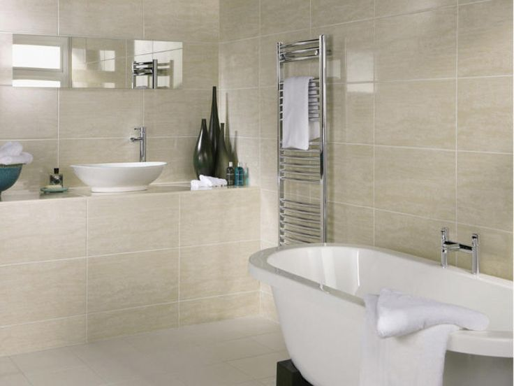photo of large beige white ceramic crown tiles bathroom with bathroom tiles free standing bath