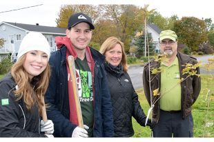The TD Bank along with the Town of New Glasgow is in the process of planting more than 100 trees in four locations around the town on Saturday. Shown from left are: Nicola Smith and Chris Penny of TD/Canada Trust, New Glasgow town councilor Nancy Dicks and Bruce Carter of Tree Canada. Kevin Adshade – The News