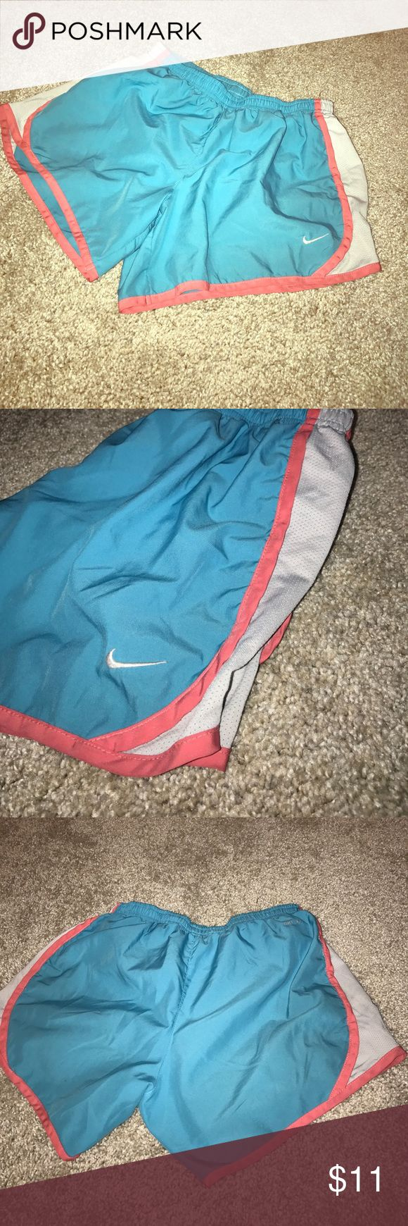 Girl's Nike running shorts Girl's XL Nike running shorts. Teal blue and bubblegum pink. Inside string has been cut out. Nike Bottoms Shorts