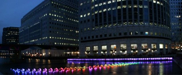 London Paper Boats  Aether & Hemera   Installation at London's Canary Wharf, presented until 15 February 2013. Called Voyage, this beautiful creation offers a fleet of 300 boats illuminated recalling the form of paper boats that can change colors.