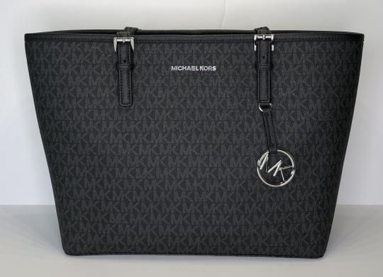 4a429bd7157d Michael Kors Jet Set Travel Md Carryall Tote Signature Mk Black Saffiano  Leather Shoulder Bag. Get one of the hottest styles of the season!
