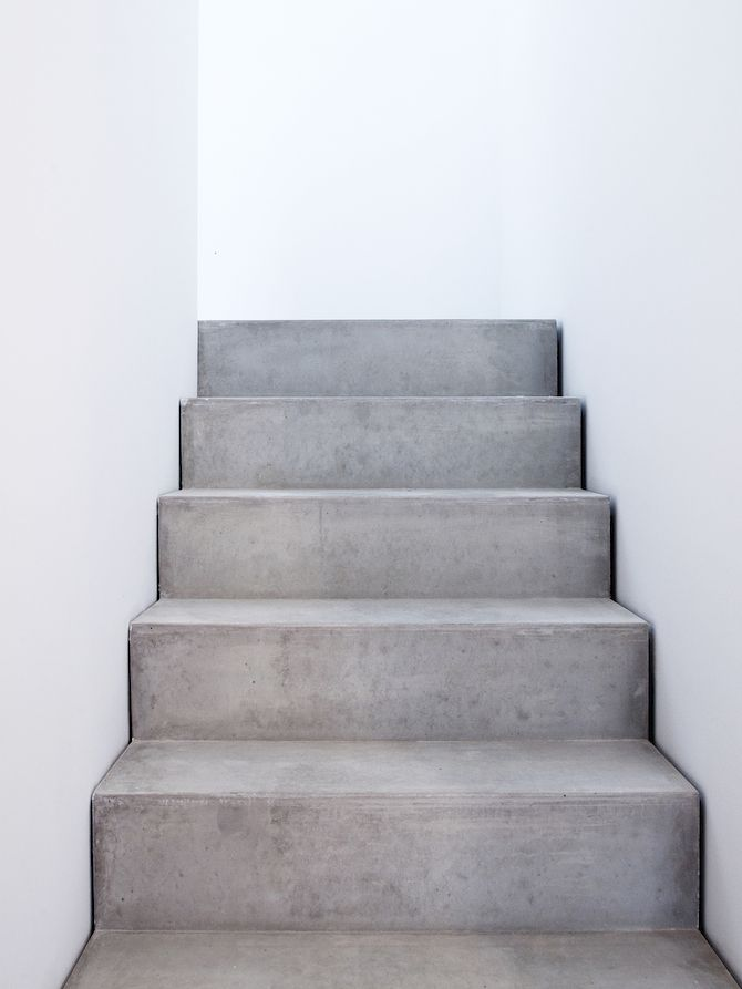 stairs concrete grey wide white walls