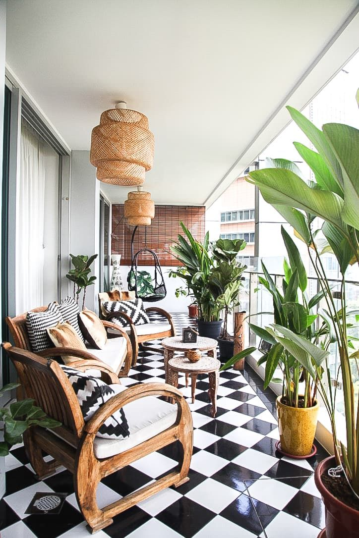 A world traveler calls Singapore her home (for now) and has filled her apartment with decor and inspiration from her travels. Her basic balcony space was taken to another level with the addition of the perfect decor and plants!