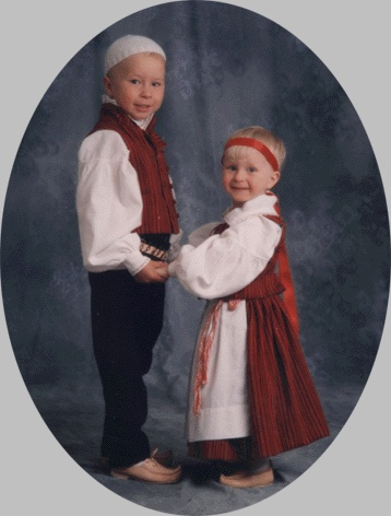 Children wearing traditional costumes in Finland.