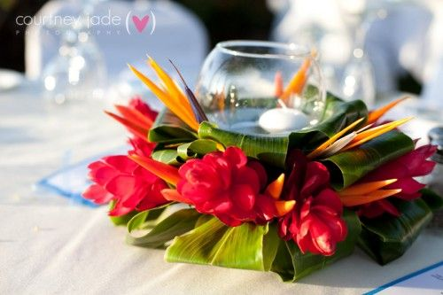 Elegant Hawaiian Style Centerpieces   Colorful, exotic decor for a tropical wedding celebration…