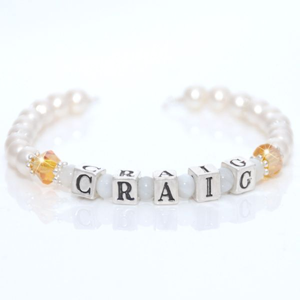 Carey Baby Name Bracelet for boys & girls - This beautiful sterling silver name bracelet makes the perfect gift for newborns, christenings, 1st Birthday or Christmas, 1st Holy Communion, Page Boys, Flowergirls or for any occasion. It is a perfect design for both boys and girls. Crafted with genuine Swarovski crystals and pearls.