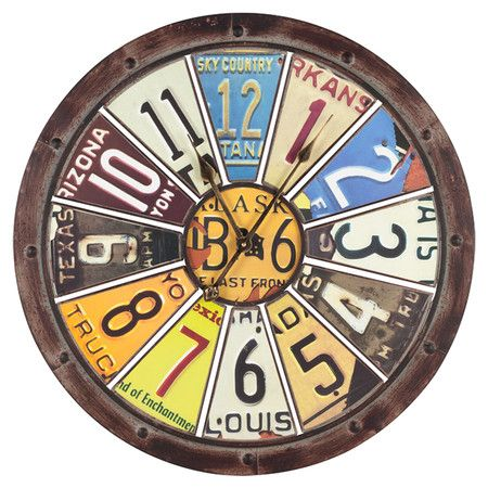 Distressed metal clock in brown with a license plate motif.   Product: ClockConstruction Material: Metal...