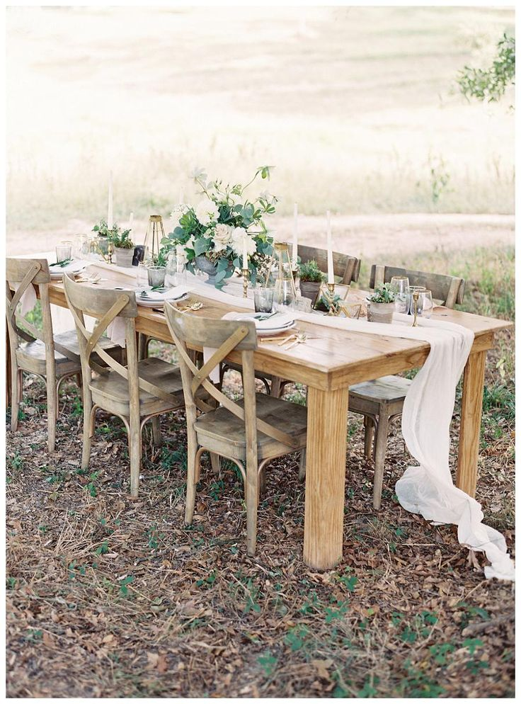 Outdoor wedding inspiration with a bare wood table, silk runner, soft florals and wooden X-back chairs. Event design by Love & Honey, florals by Nectar. Image by Allison Kuhn Photography at The Ivy Place in Lancaster, SC.