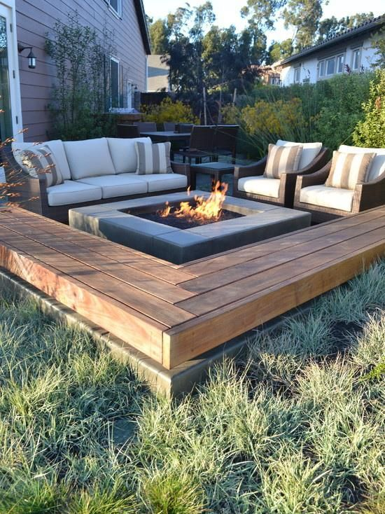 modern, fixed bench around fire pit.