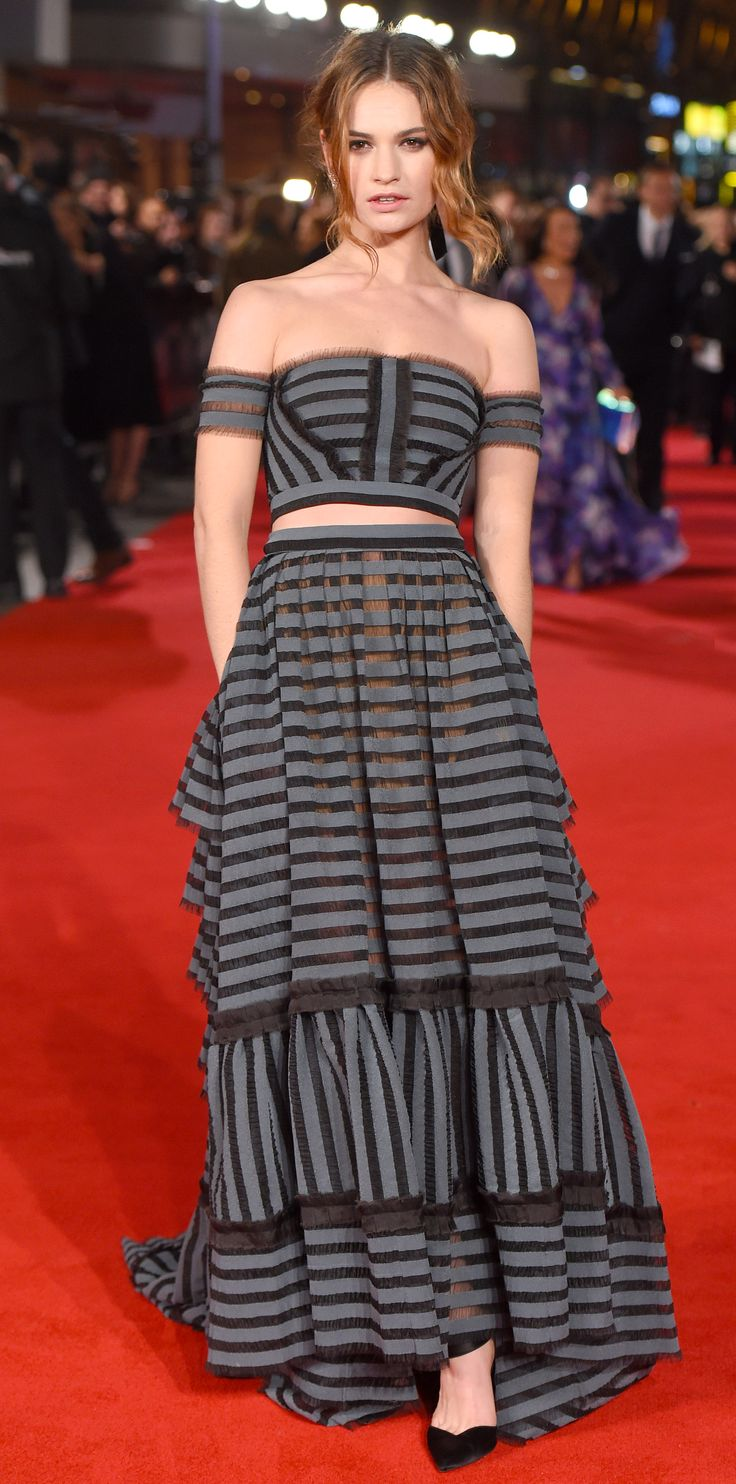 Lily James was absolutely radiant at the UK premiere of Pride and Prejudice and Zombies in an off-shoulder striped bralet and matching ground-grazing skirt by Erdem, with black Aquazzura pumps.