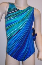 Cute gymnastics and/or dance leotard in a CASCADE STRIPE (green to blue) spandex. Pattern is delightfully reversed in back. Available in tank or racer back. Free scrunchie as always!