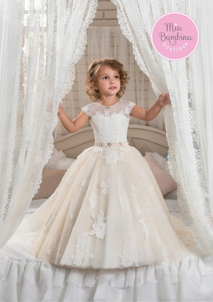 Your flower girl will look adorable in the New Orleans dress! Floor-length dress with train features illusion neckline with sweetheart underlay bodice covered with elegantly crafted lace appliques. Pr