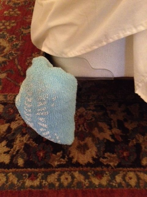 After the sock is completely filled with plastic bags cover it with the bed skirt.