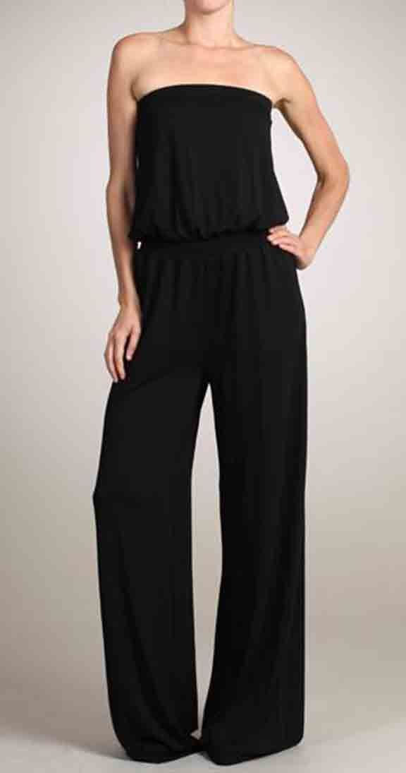 """Carrie Romper :      Strapless romper     Wide leg with full length     Ruched elastic waistline     This model is wearing size Small. Measurements are 32x24x34 and height is 5' 7""""     Drape'y fabric 95% Viscose 5% Spandex     Made in the USA"""