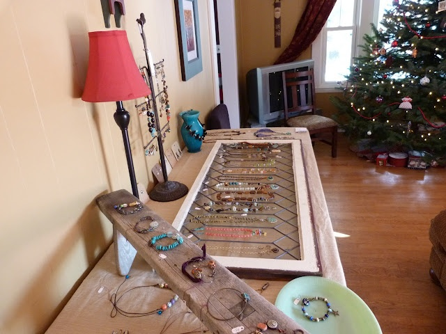 Jewelry party display - i like the wooden bench