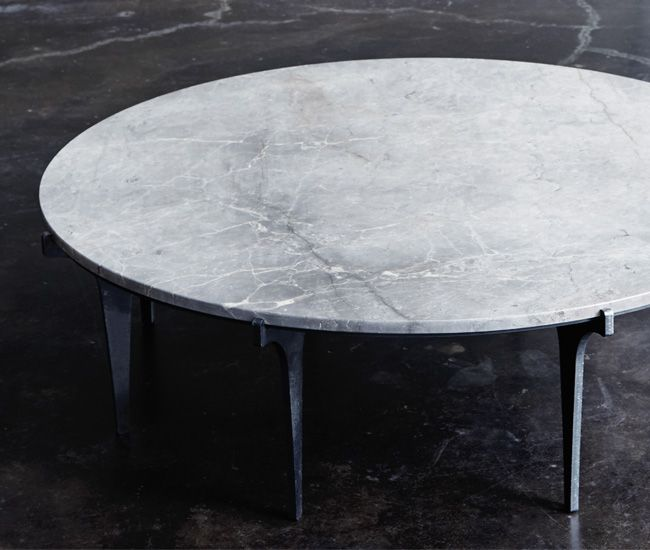Feel like King Arthur with this regal mottled Montauk coffee table. A slab of marble (over a metre in diameter) sits on cold-rolled steel legs that recall a castle's portcullis.