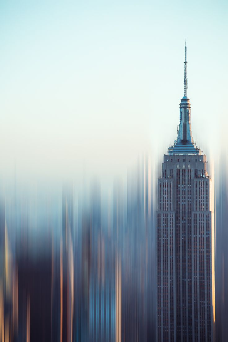 NYC. The Empire State stretches towards the heavens. The abstract beauty of New York City is what I love the most. Fine art photography print by Sonja Quintero of Squint Photography. Empire Blur